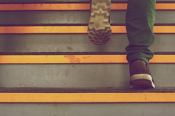 be proactive | man walking up stairs