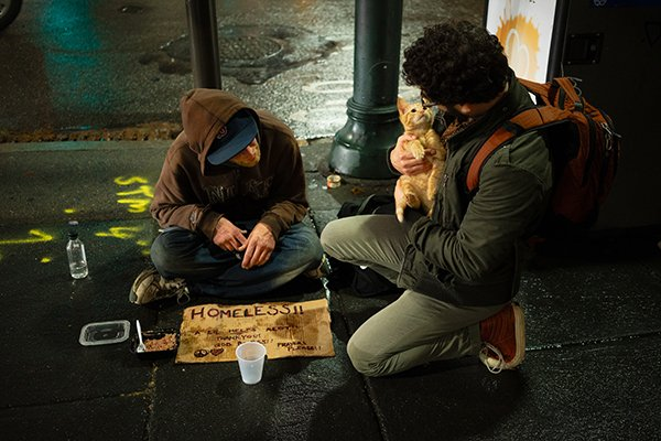 human kindness | man comforts homeless man