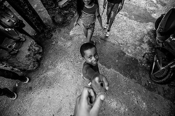 moral character | man holding child's hand
