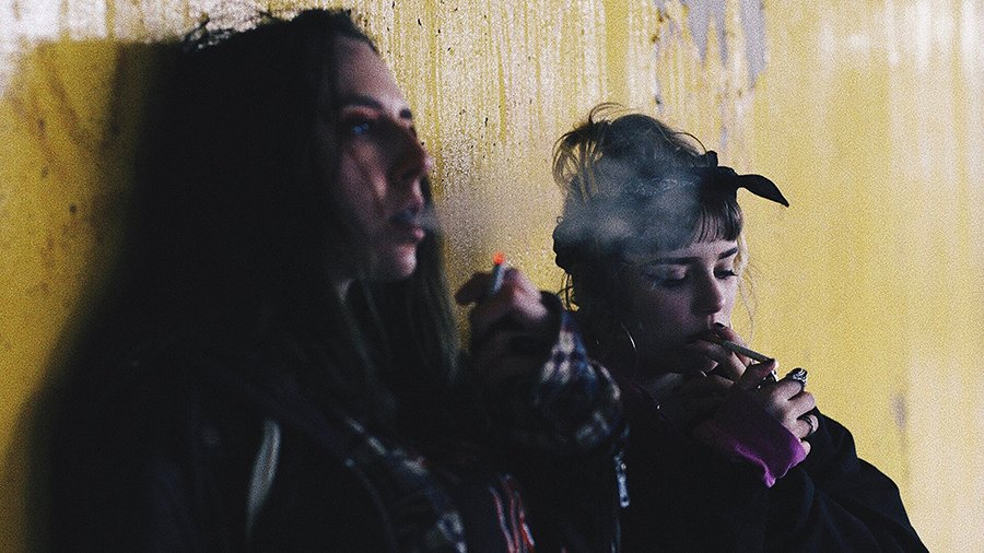 Tolerate | Women smoking cigarettes'