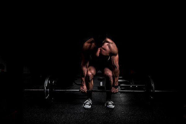 strength your best   man performing deadlift