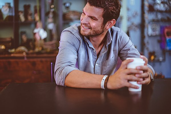 happy | man holding coffee cup and smiling
