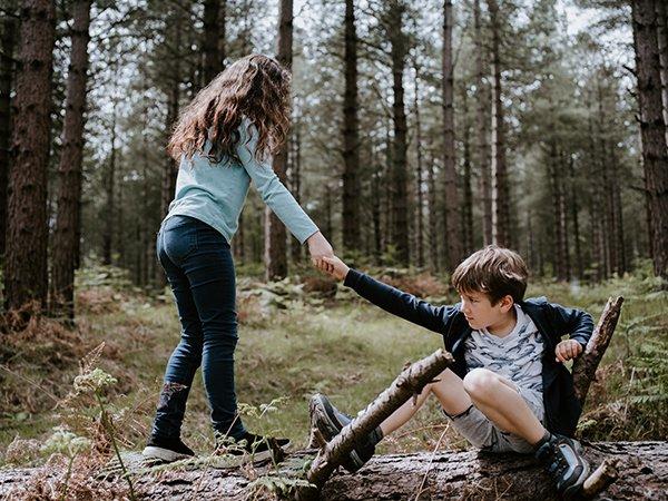 helping hand | girl helping boy up
