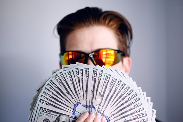 wealth   man with a lot of money