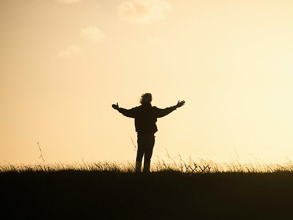 be responsible | man standing in field with arms open