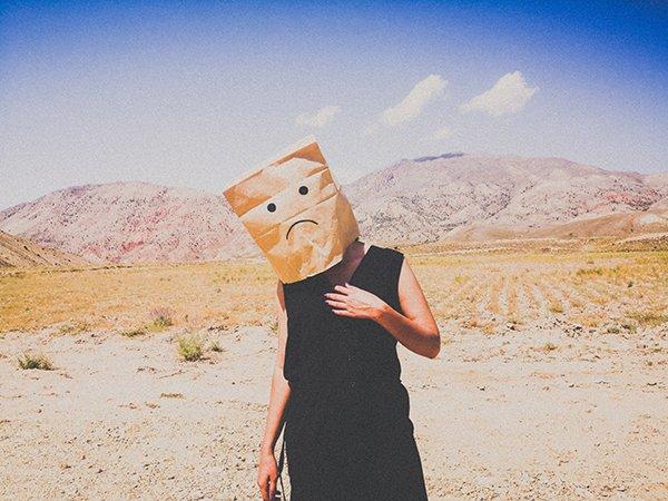broken person | woman in desert with bag over head