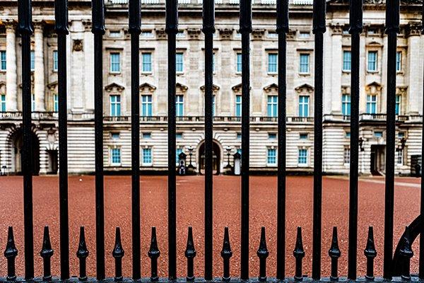 elites ruling & classes | gates outside of a large mansion