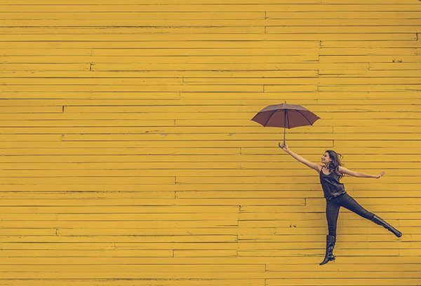 potential | woman jumping with umbrella