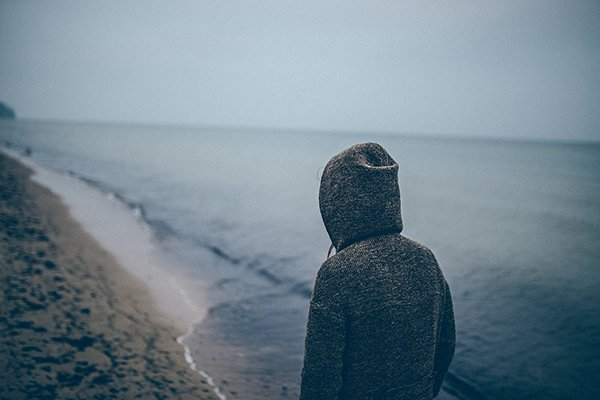 resentment | man standing at beach