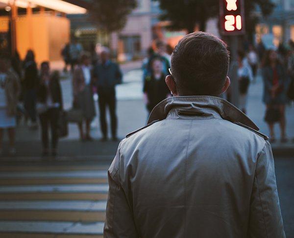 seeking approval | man walking toward crowd